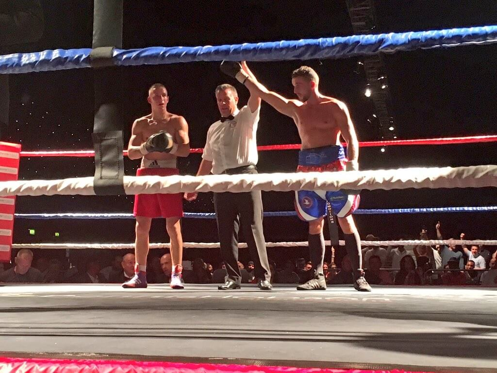 RP Davies (right) has his hand raised after his latest win